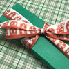 Ginger bread ribbon tied on a green box is the perfect gift for the baker in your life!
