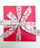 Wrap a festive gift in pink to add warmth and fun to your holiday packages!