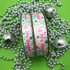 """Our Feliz Navidad ribbon comes in 5/8"""" and 7.8"""" widths for all your decorating needs!"""