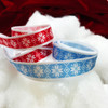 """Our Nordic design snowflake ribbons are available on red and ice blue backgrounds printed on 5/8"""" white single face satin ribbon."""