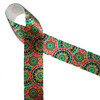 """African tribal medallion print in pink, green, black and yellow printed on 1.5"""" white single face satin ribbon is an ideal ribbon for  hair bows, head bands, gift wrap, Kwanza, festivals and cultural celebrations. Be sure to have this ribbon on hand for crafts, quilting, sewing and craft projects. All our ribbons are designed and printed in the USA"""