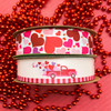 Our Valentine truck ribbon pairs perfectly with tossed hearts! Make a gift extra pretty by combining these two ribbons on the package! The recipient will love it!