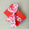 A fun little gift looks sweet with our watercolor dots ribbon tied in a  bow!