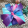 A gift made extra special with our ombre mermaid scales ribbon!