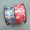 Our seashell ribbon comes in pink and blue! Pick a color theme for your project and we have you covered!