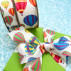 Our Hot Air Balloon ribbon comes in two sizes and fabrics! There's an option for every need!