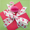 Pink flamingos tied on a pretty pink box are ready for gift wrap or party favors!