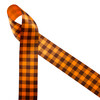 """Gingham check in brown and orange printed on 1.5"""" tangerine single face satin ribbon is a Fall classic! This traditional plaid is ideal for Fall decor, wreath making, gift wrap, sewing, quilting and craft projects! Be sure to have this ribbon on hand for hair bows, head bands and hat bands to celebrate Autumn! All our ribbon is designed and printed in the USA"""