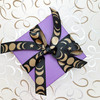 Moon phase ribbon tied on a purple package makes for a pretty gift for any celestial  themed celebration!