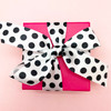 There's nothing prettier than black and white and pink! This little pink box looks oh so sweet tied with our black and white ribbon!