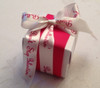 We decorated this box with red grosgrain and then tied Don't Stop Believin' in a pretty bow for a stand out favor box.