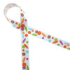"""Tossed candies on 7/8"""" white single face satin ribbon"""