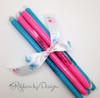 Pink and blue candy sticks are a fun favor for a baby reveal party!