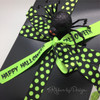 A Halloween gift box with a mix of neon green dots and Happy Halloween in neon green and black will make the recipient smile!