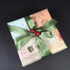 An elegant vintage gift tied with our tone on tone green satin ribbon.