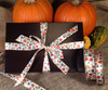 Our Falling leaves and pumpkin ribbon tied on this dark brown box makes an ideal Fall gift!