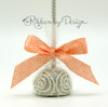 This pretty little cake pop is all dressed up in our peach fish scale ribbon and ready to be presented to the wedding guests as favors! What a beautiful gift!
