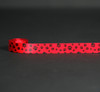 "Paw prints in black on 5/8"" red single face satin ribbon, 10 Yards"