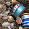 Our mermaids mix and match with many of the ribbons in our Nautical Collection to create an interesting vignette!