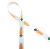 """Bright orange carrots with green toppers line up on 5/8"""" white single face satin to welcome the Easter bunny in style!"""