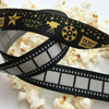 Pair our Movie Film strip ribbon with our Movie themed ribbon in gold and black for a very special Movie night or Oscar party!