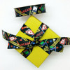 Tie our Arcade themed ribbon on a fun colored box to carry the theme of the party to the next level! Designed and printed in the USA