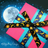 Our celestial ribbons in blue and black tied on a vibrant pink package makes a very dreamy gift!