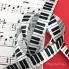 Our fun keyboard ribbon will make any music lover sing when this ribbon is on a gift or favor!