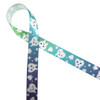 """Tooth themed ribbon for a visit from the  tooth fairy or a gift for the dentist is printed on a 5/8"""" white single face satin ribbon with sleepy and happy molars with stars on an ombre background from green to purple!"""