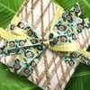 This fun little package is paired with a yellow gingham ribbon to really make the pattern pop! Combining ribbons on a single package makes for some very interesting gift wrap!
