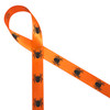 """Black spiders crawling along our 5/8"""" tangerine single face satin ribbon makes for an idea Halloween treat topper!"""