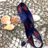 Make our lobster ribbon part of your Summer fun! This is a great lanyard for family or corporate clambakes and a great souvenir to remember the event!