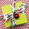 These sweet little elf shoes are just the cutest tying a small box! No wrapping paper needed!