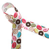 "Donuts printed in pastel colored frostings are tossed along our 1.5"" white single face satin!"