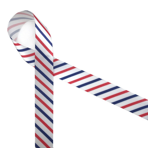 """Stripes of red, white and blue printed on 7/8"""" white single face satin ribbon is an American tradition for celebrating our patriotic holidays. This is a great ribbon for parade streamers, party decor, wreaths, hair bows and floral design and gift wrap! All our ribbon is designed and printed in the USA"""