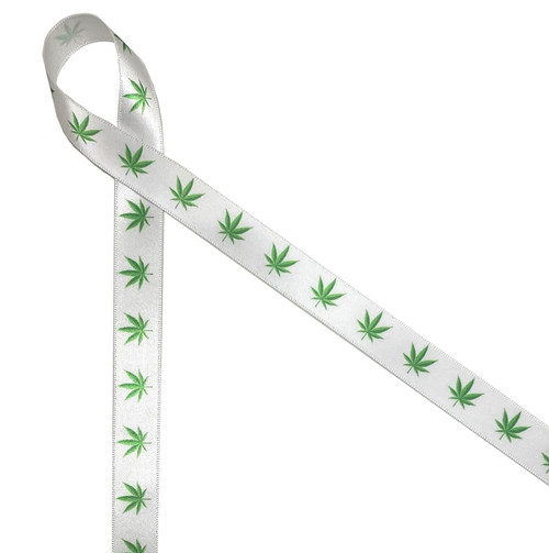 "Marijuana leaves in shades of green printed on 5/8"" white single face satin ribbon is an ideal ribbon for packaging CBD products!"
