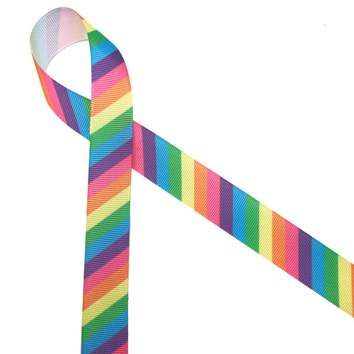 """Pastel  stripes in pink, yellow, blue, purple and  green printed on 7/8"""" white grosgrain ribbon is such a fun ribbon for hair bows, hat bands, fascinators, crafts and sewing projects! Be sure to have this ribbon on hand for all your new colorful and creative ideas."""