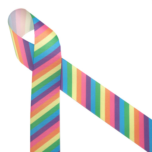 """Pastel  stripes in pink, yellow, blue, purple and  green printed on 1.5"""" white grosgrain ribbon is such a fun ribbon for hair bows, hat bands, fascinators, crafts and sewing projects! Be sure to have this ribbon on hand for all your new colorful and creative ideas."""