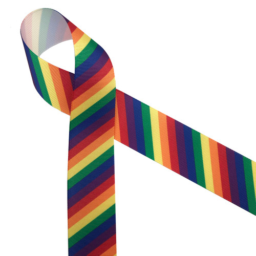 """Rainbow stripes in primary colors of red, yellow, orange, green, blue and purple printed on 1.5"""" white grosgrain ribbon is such a fun ribbon for hair bows, hat bands, fascinators, crafts and sewing projects! Be sure to have this ribbon on hand for all your new colorful and creative ideas."""