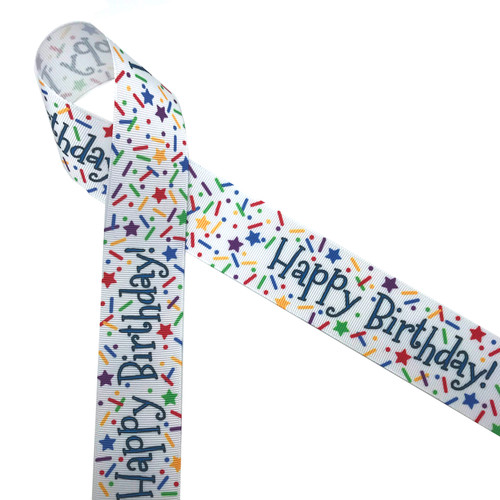 "Happy Birthday with sprinkles in primary colors printed on 1.5"" white grosgrain ribbon is ideal for celebrating that special day! This is an ideal ribbon for gifts, crafts, scrapbooking and party favors! Our ribbon is designed and printed in the USA"