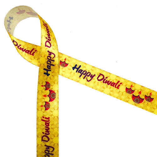 "Happy Dwali with pink oil lamps on a yellow swirled background printed on 5/8"" white single face satin ribbon is the ideal ribbon for celebrating Indian Hindu festival of lights. Our ribbon is designed and printed in the USA"