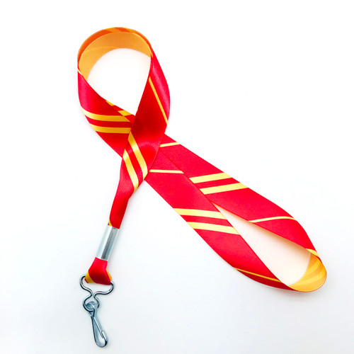 "Hogwarts Gryffindor House ribbon lanyard in red and yellow  stripes printed on 7/8"" yellow single face satin ribbon is a fun gift idea for all the Harry Potter fans on  your gift list. Perfect for events, parties and weddings too! All our products are designed, printed and assembled in the USA"
