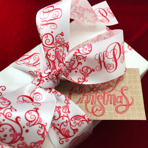 """Red and white personalize monogram ribbon features a red custom designed Chinoiserie pattern with a beautiful matching font on 1.5""""  white single face satin ribbon. This ribbon will add elegance and grace to every Christmas gift. Our ribbon is designed and printed in the USA"""