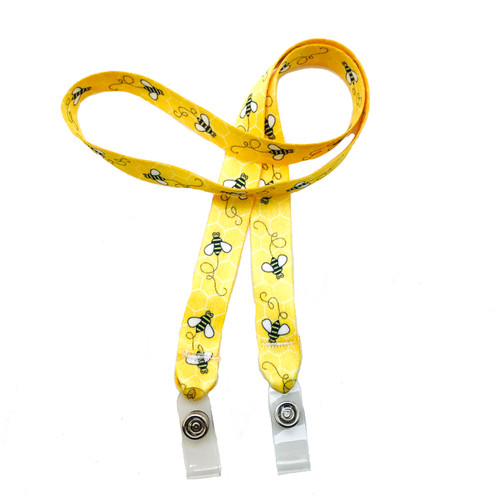 "24"" mask holder with soft plastic snap closures printed with our Bee theme design printed on both sides on  5/8"" Ultra Lanyard material is  perfect for adults to keep track of face masks at  work, school, sports practice, lunch and break time."