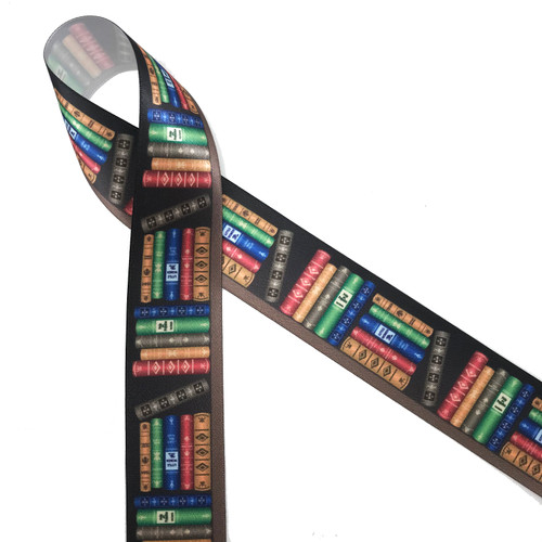 "Our book themed ribbon printed on 1.5"" white single face satin is the ideal gift wrap ribbon for the librarian, book lover, book worm or book seller in your life. This beautiful luxury ribbon is ideal for quilting, sewing, scrapbooking and craft projects of all kinds. All our ribbons are designed and printed in the USA"