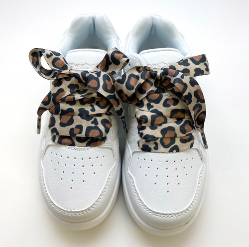 Satin shoelaces leopard print design is perfect for adding some fun and fashion to your sneakers! This is a great shoelace for fun dance shoes, wedding shoes, cheerleading and recitals! All our ribbon shoelaces are printed using dye sublimation technology and can be washed, ironed and re-used! All our laces are designed and printed in the USA