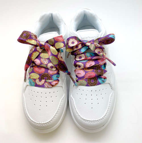 Satin shoelaces donut design is perfect for adding some fun and fashion to your sneakers! This is a great shoelace for fun dance shoes, wedding shoes, cheerleading and recitals! All our ribbon shoelaces are printed using dye sublimation technology and can be washed, ironed and re-used! All our laces are designed and printed in the USA
