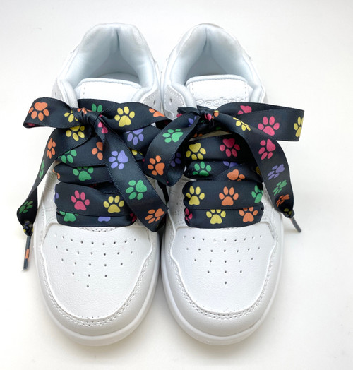 Satin shoelaces rainbow paw print  design is perfect for adding some fun and fashion to your sneakers! This is a great shoelace for fun dance shoes, wedding shoes, cheerleading and recitals! All our ribbon shoelaces are printed using dye sublimation technology and can be washed, ironed and re-used! All our laces are designed and printed in the USA