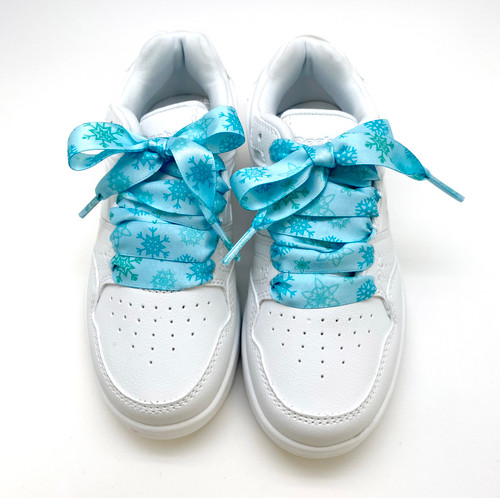 Satin shoelaces tie Frozen snow flake design is perfect for adding some fun and fashion to your sneakers! This is a great shoelace for fun dance shoes, wedding shoes, cheerleading and recitals! All our ribbon shoelaces are printed using dye sublimation technology and can be washed, ironed and re-used! All our laces are designed and printed in the USA