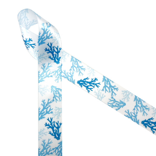 "Coral Reef  patterns are trending in home decor and fashion! Our coral reef ribbon in shades of blue printed on 1.5"" white single face satin is perfect for any beach, tropical or reef themed event! This is the perfect ribbon for tying gifts for a tropical themed wedding or bridal shower! Be sure to have this beautiful ribbon on hand for all you Summer crafting! Our ribbon is designed and printed in the USA"